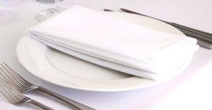 clean table napkin on a white plate