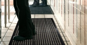 employees standing on a black anti fatigue mats