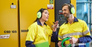 male and female industrial worker discussing