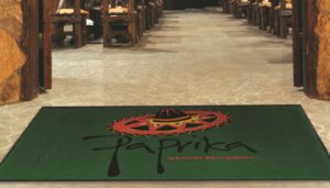 Paprika Mexican restaurant logo printed on the entrance mat