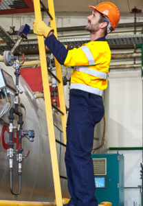 male industrial worker holding a yellow ladder