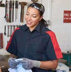 smiling female employee wearing a black coloured shirt with red stripes