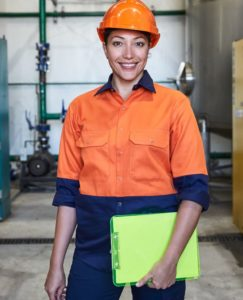 female industrial worker wearing orange and navy hi vic work shirt