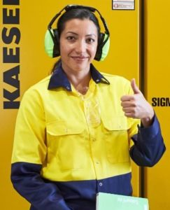 female industrial worker wearing a navy and yellow Hi Vic uniform