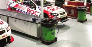 ecosafe washer placed in front of racing cars