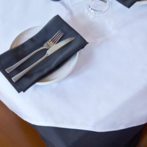 White Overlay with Black table cloth and napkin