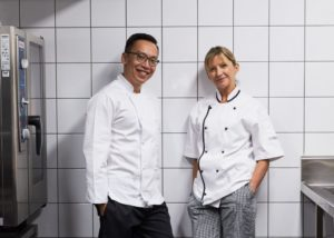 male and female wearing white chef uniform