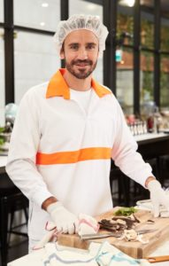 male employee wearing Alsco white food shirt with trim
