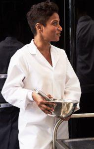 female employee wearing a white food coat