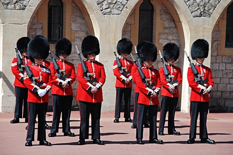 British guards wearing red and black uniform.