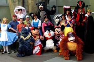 Different Disney characters with people taking pictures.