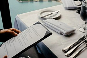 Looking at the menu in a restaurant