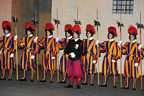 Swiss guards in formation wearing their uniforms.
