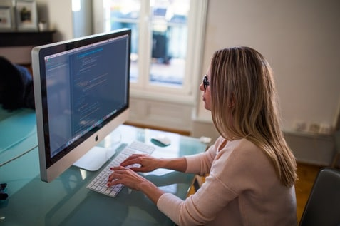 A woman working in front of the computer