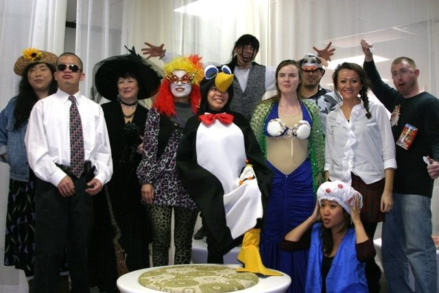 Happy colleagues wearing different costumes