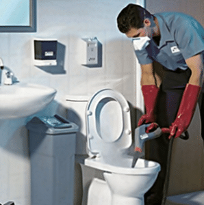 A man fixing the damaged toilet bowl