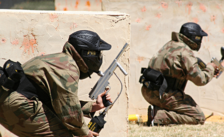 Two people playing pumping paintball games