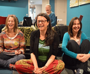 Female employees joining a laughter yoga class
