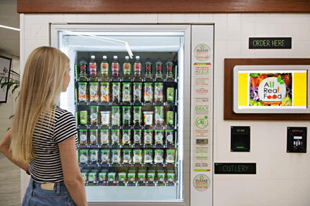 A lady looking at the vendo machine