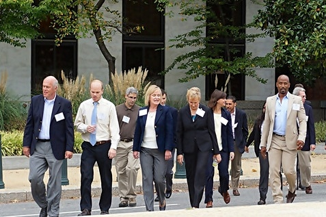 Corporate individuals walking for business purposes