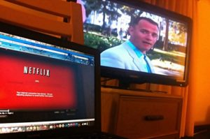 Watching Netflix movies and TV shows through a laptop and a TV