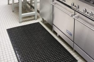 black wet area mat on the kitchen floor