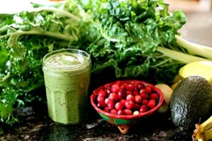 Healthy green smoothie made from fresh fruits and vegetables