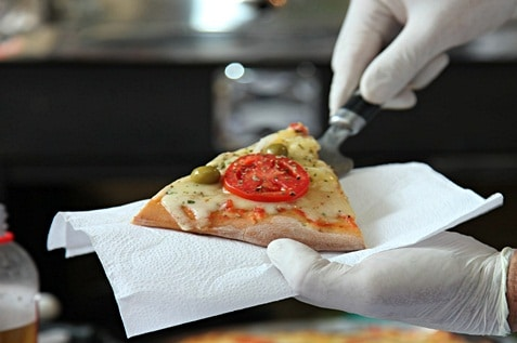Serving a slice of pizza