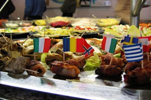 International cuisine recognised in small flags from different countries