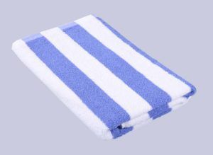 folded clean white and blue stripped bathtowel
