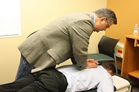 A man massaging his colleague
