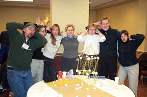 Happy employees having their team building