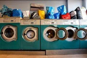 Five green heavy duty washing machines