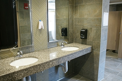Clean restroom with two sink