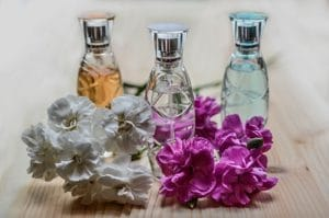 Three bottles with different scent and flowers