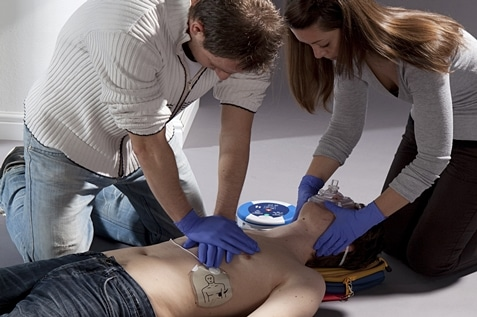 Man and woman conducting first aid training