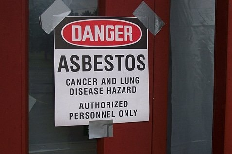Door warning sign about the danger of Asbestos