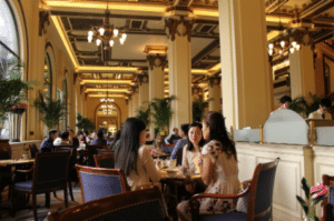 People chatting inside the luxurious hotel