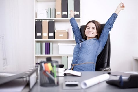 Happy female employee stretching her hands