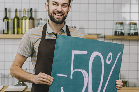 happy male employee holding a discount board