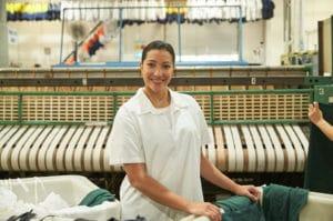 happy employee wearing a white uniform